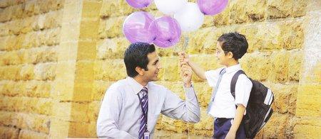 School Student Holding Balloons